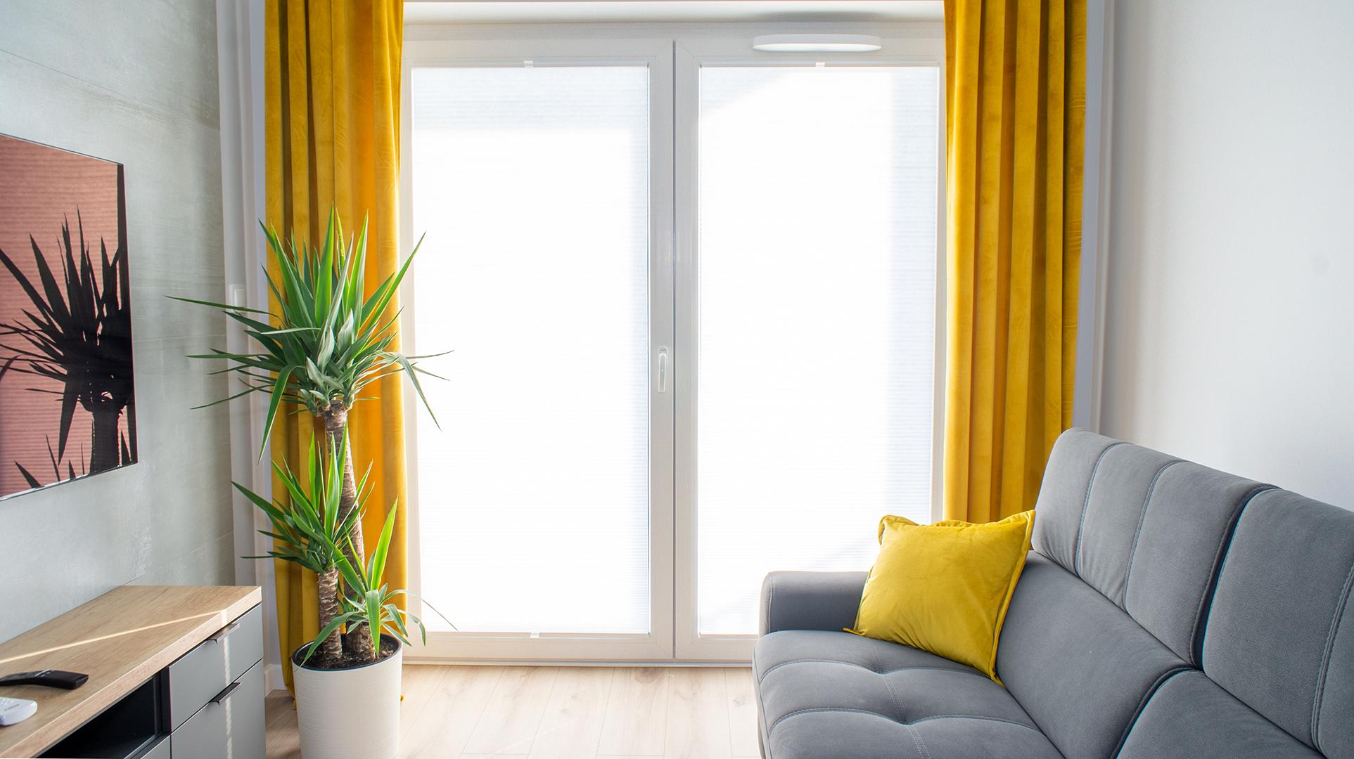 Plisy na oknie balkonowym realizacja w Poznaniu